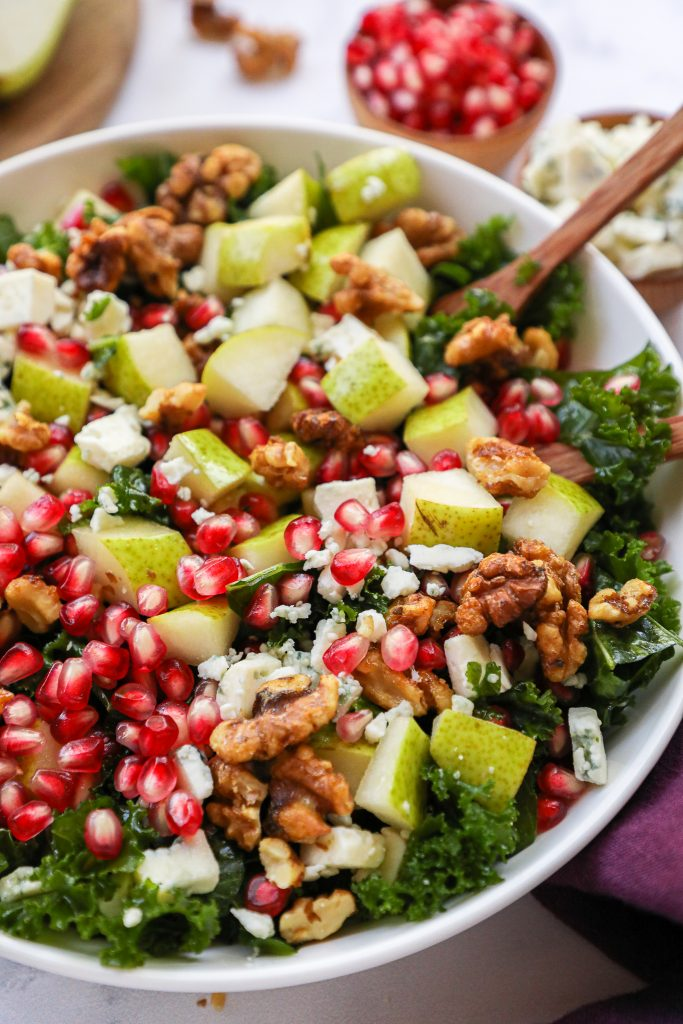 Looking for a healthy side dish this fall? Try making this tasty pear and kale salad! It's loaded with fresh fruit, healthier candied walnuts and a super simple balsamic dressing too!