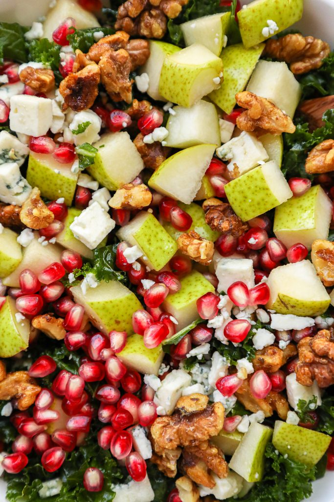 An easy fall salad made with pears, pomegranate seeds, gorgonzola, candied walnuts and a maple balsamic dressing! It's the perfect side salad for fall!