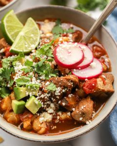 This delicious pork pozole is so easy to make and is loaded with flavor! There's no doubt it's become a family favorite in no time!