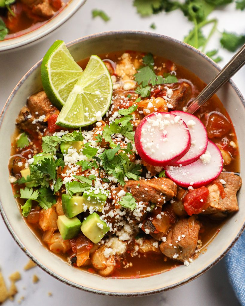 Let you slow cooker do all the work for dinner with this healthier pork pozole! It's made with real ingredients and is packed full with Mexican flavors!