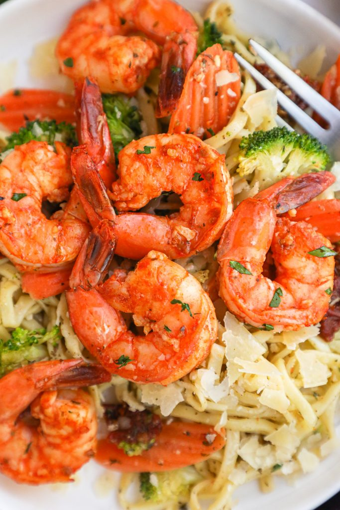 Sun dried tomato shrimp is an easy simple dish made with chopped sun dried tomatoes, garlic, lemon and a little bit of butter! It's full of flavor and pairs so well with your favorite pasta dish!