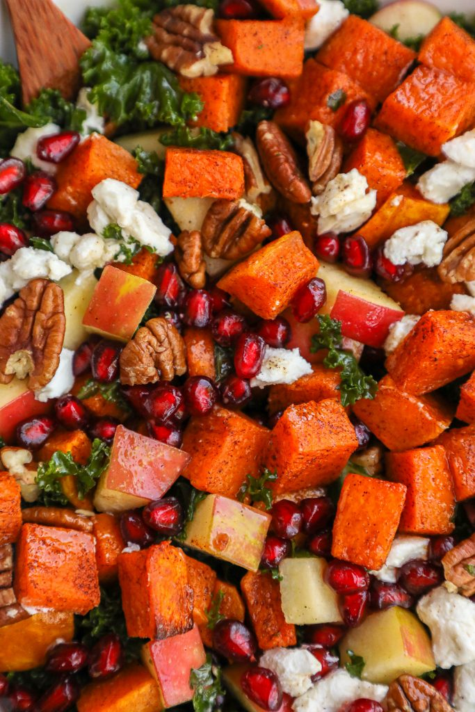 Cinnamon roasted butternut squash, crisp apples, juicy pomegranate arils, creamy goat cheese and tender kale are all tossed in a sweet apple cider vinaigrette and topped with toasted pecans! It's the perfect autumn side salad!