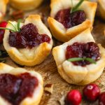 Easy cranberry and brie bites made with only 3 ingredients! They're the perfect appetizer for Thanksgiving or any holiday party!!