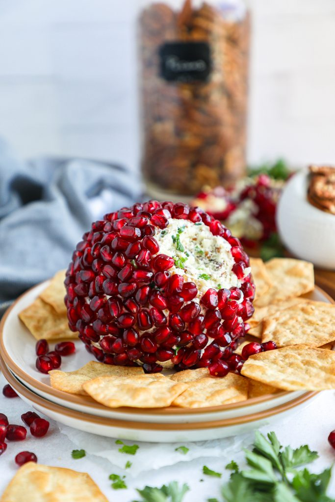 This is the best and easiest appetizer you will ever make! This festive cheeseball is loaded with so many different flavors and just screams Christmas too!