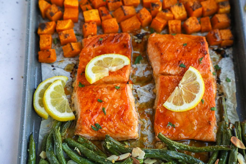 This tasty sheet pan meal is a simple recipe using minimal ingredients but is also exploding with flavor! It's made with sweet glazed salmon and the best winter produce!