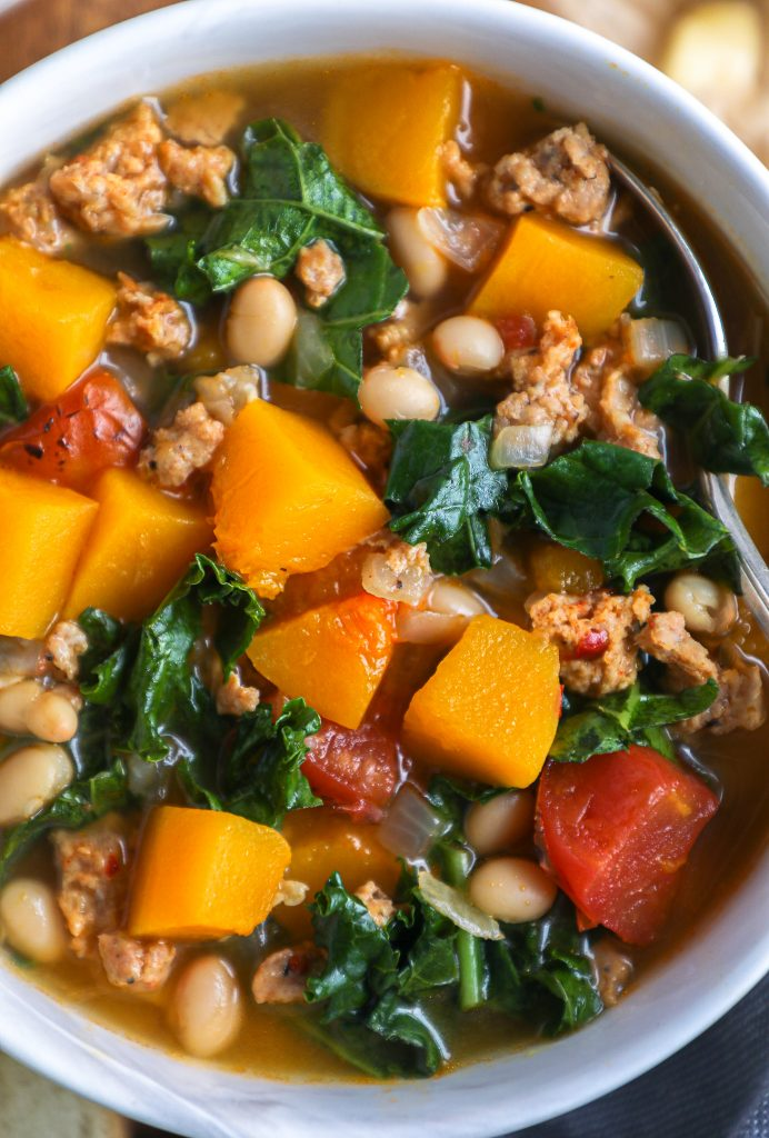 Spicy Italian sausage, butternut squash, kale, white beans and fire roasted tomatoes are all you need to make the best fall/winter soup!