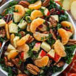 A light and refreshing kale salad made with chopped apples, mandarin oranges, dried cranberries and toasted pecans! It's then tossed in the best homemade poppy seed dressing!