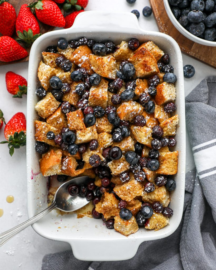 Sourdough bread pieces, maple syrup and blueberries come together to make this delicious french toast casserole recipe! It's an easy no fuss breakfast that will become a family favorite in no time!