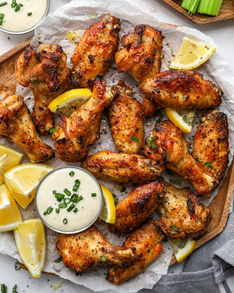 Crispy lemon garlic chicken wings are the perfect appetizer for your next game day party! They're baked instead of fried and so easy to make too!
