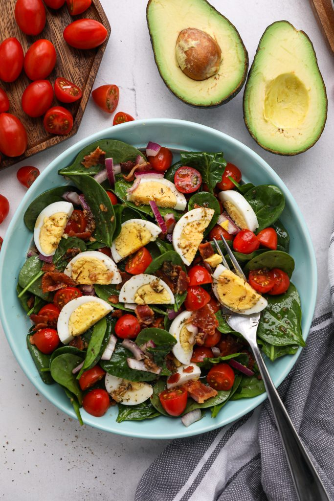 This tasty salad recipe teaches you how to hard boil eggs, bake bacon in the oven and has the best recipe for a homemade red wine vinaigrette too!