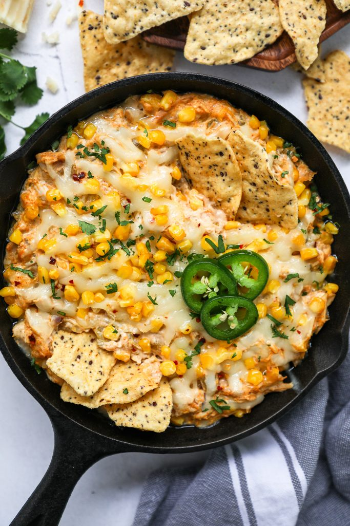 An easy and delicious dip made with all the flavors of your favorite enchilada recipe! It's spicy, cheesy and perfect for game day!