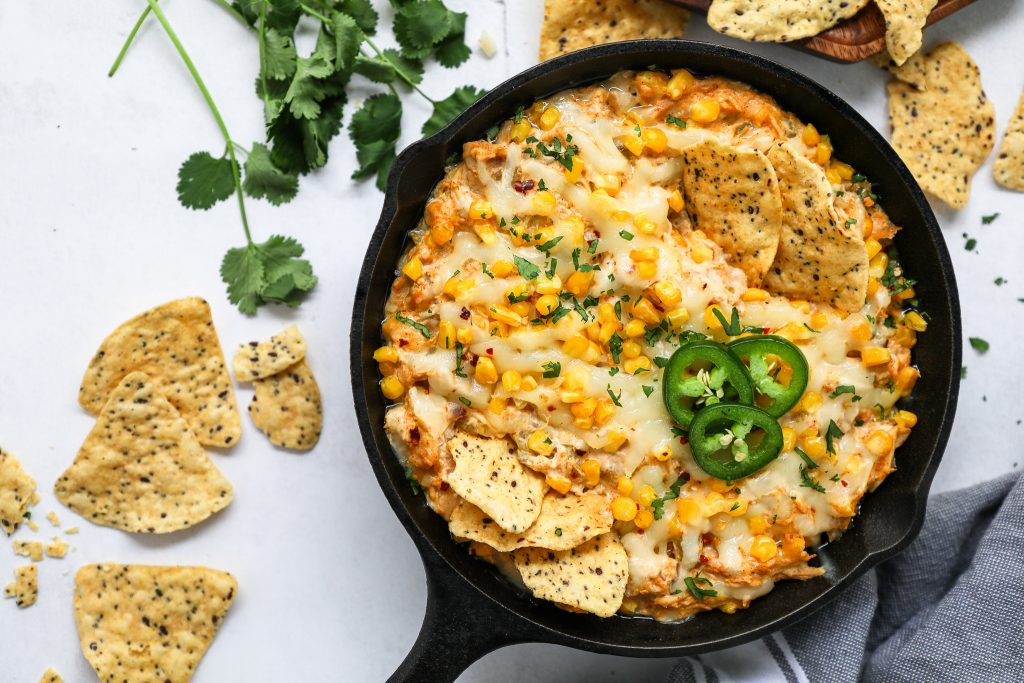 Looking for a healthier appetizer for your upcoming Super Bowl party? Try serving this tasty chicken enchilada dip with tortilla chips or sliced veggies!