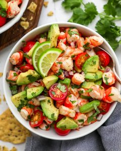 A delicious ceviche like salad that made with precooked shrimp, avocado, tomaotes, cilantro and lime juice! It's easy, flavorful and perfect for a quick meal!