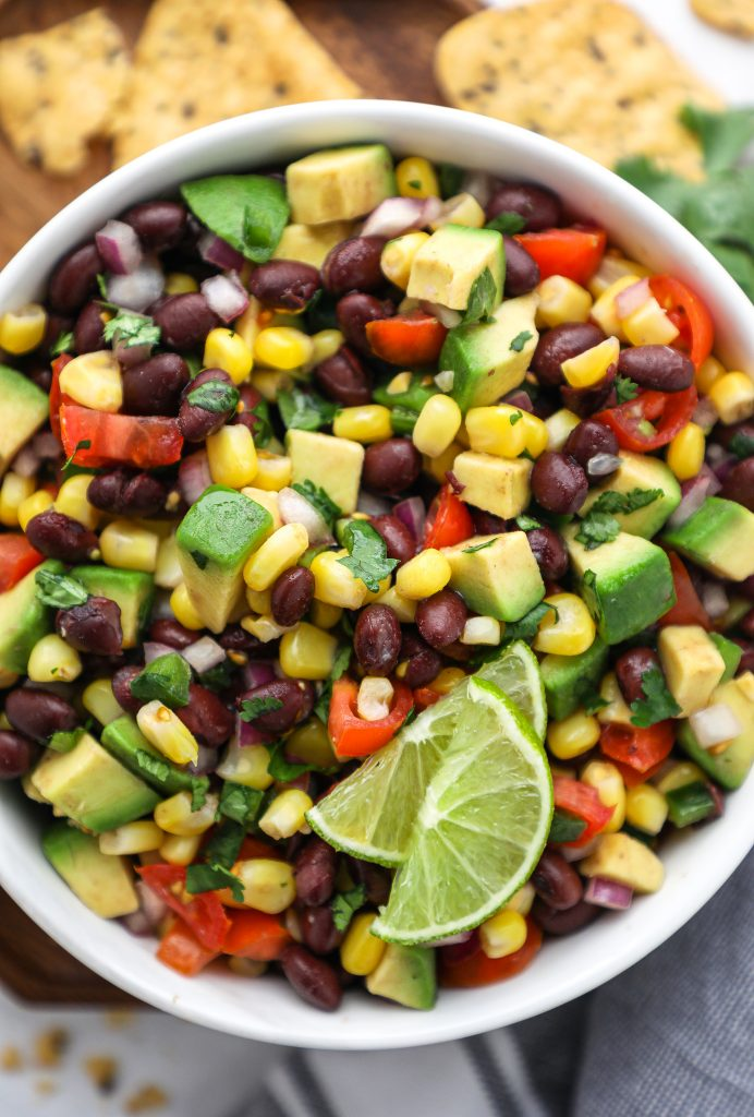 Looking for a healthier Super Bowl appetizer? Try this simple and delicious black bean and corn salsa! It's made with minimal ingredients and is gluten free and dairy free too!