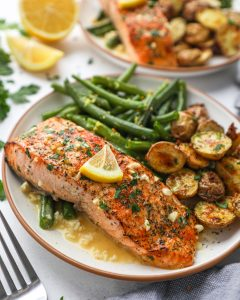 An easy dinner recipe that involves pan searing salmon filets and drizzling them with a delicious lemon dijon sauce! It's perfect for a quick meal during the week!