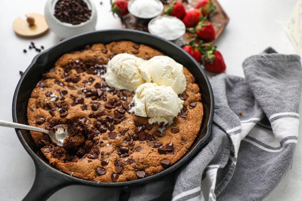 This alomnd butter skillet cookie is one of my favorite desserts! It's healthier, easy to make and loaded with chocolate chips too!