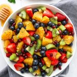 Winter fruit salad with oranges, strawberries, kiwis, blueberries and pomegranate seeds all tossed in an orange poppy seed dressing!