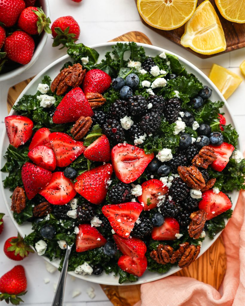 This fruity kale salad is the best side dish for spring! You can easily make it ahead of time and itis always a crowd favorite too!