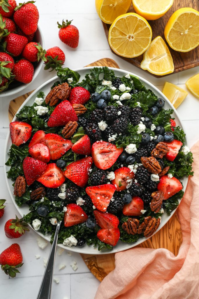 This mixed berry kale salad is perfect to serve for any outdoor party, potluck or bbq this year! It's sweet, creamy and so refreshing too!