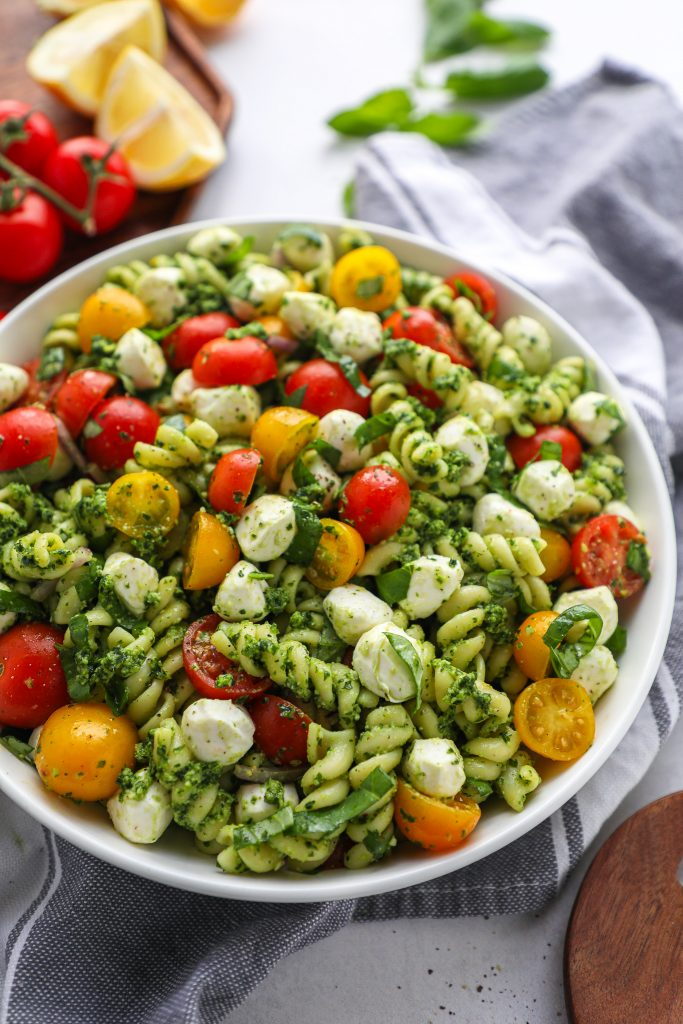 Pesto pasta salad is a great side dish for any bbq, pot luck or get-together this summer! It's simple, approachable and always a crowd favorite!