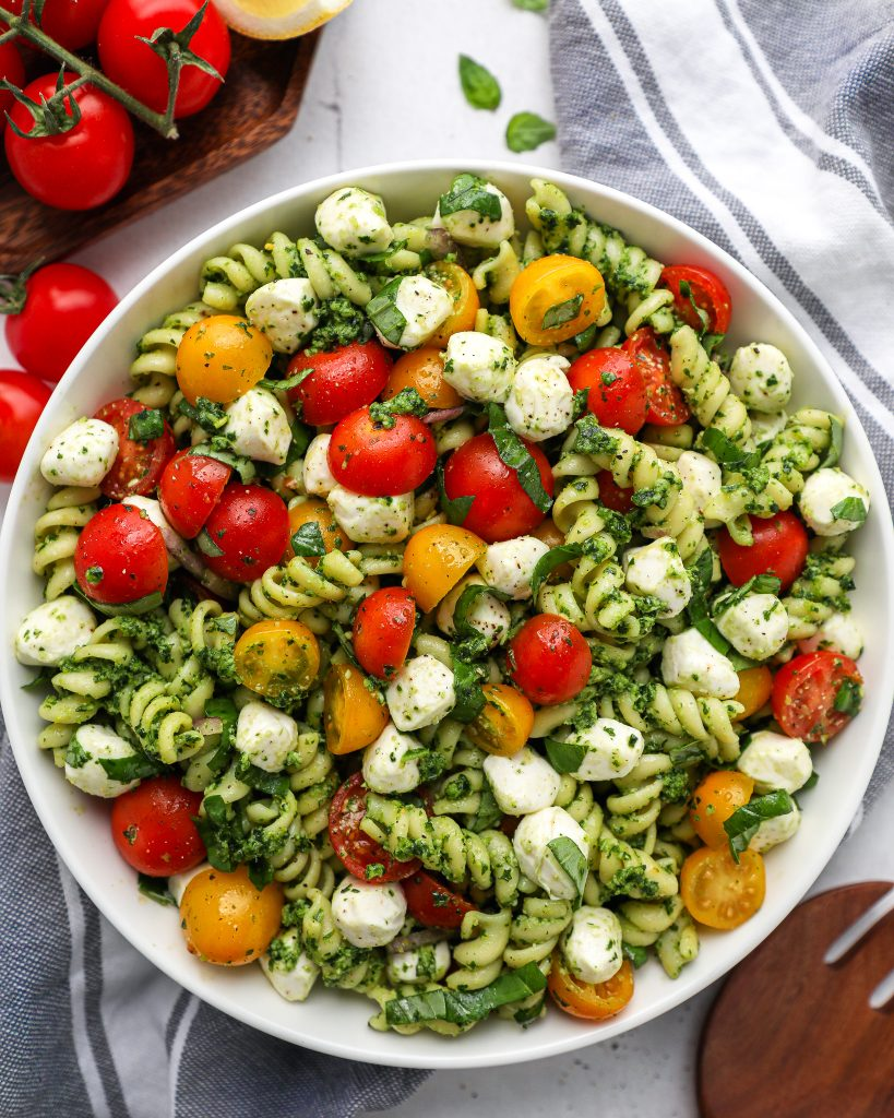 Pesto lovers - this one's for you! This pasta salad is zesty, creamy, super fresh and packs a punch with that flavor!