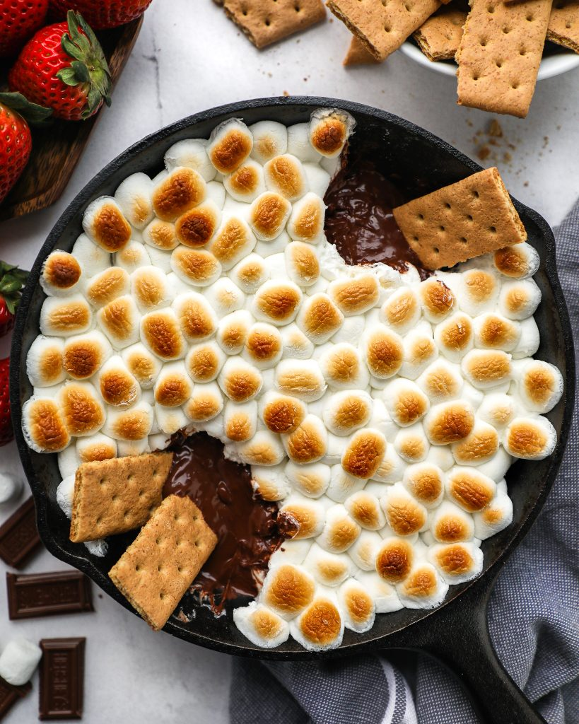 Chocolate, marshmallows and graham cracker are all you need to make this tasty dessert dip! Plus there's no campfire required because it's baked in the oven too!
