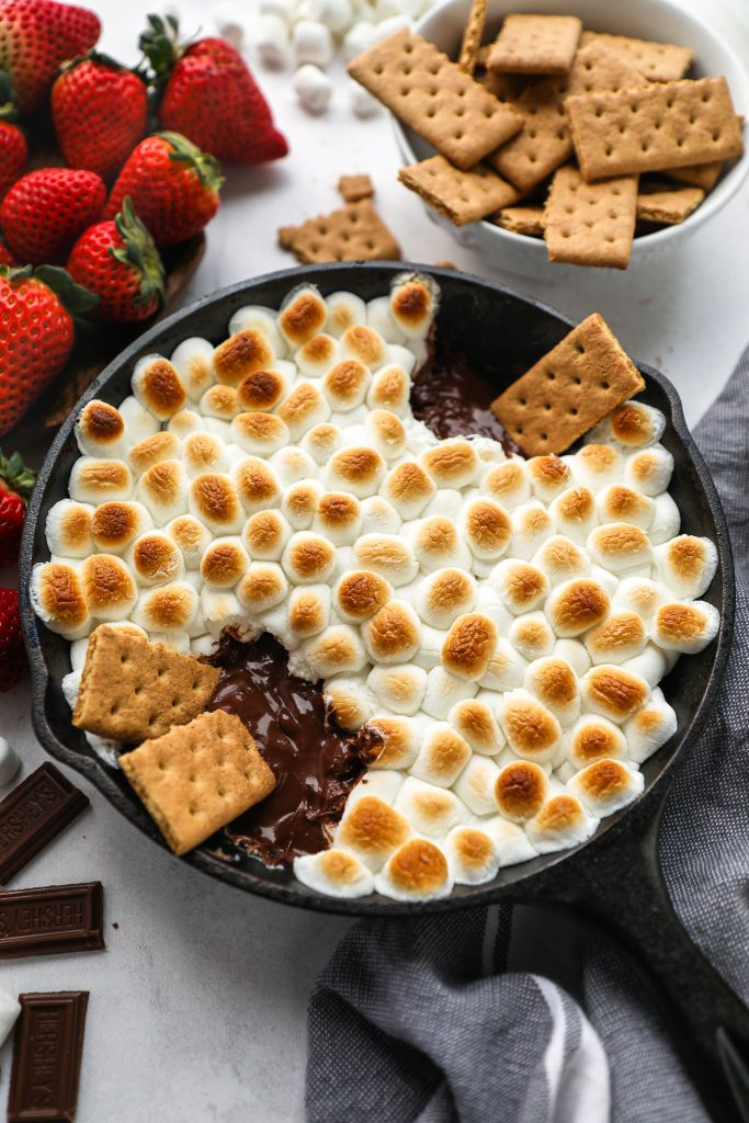 This delicious s'mores dip is just what you need this spring and summer! It's quick and easy and such a fun spin on a traditional campfire classic!