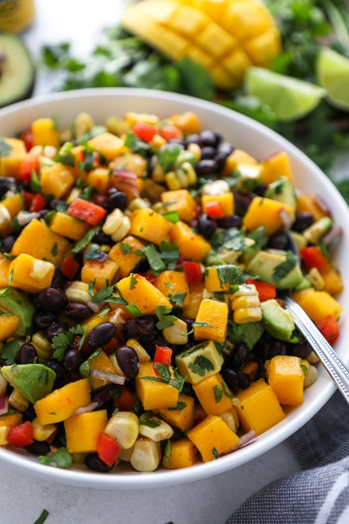 Looking for a side dish for your next potluck? Try this simple salad made with black beans, mango and avocado! It's sweet, creamy and full of Mexican spice!
