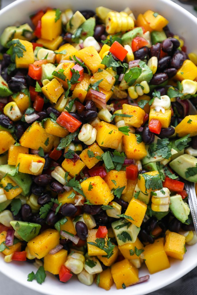 Black bean mango and avocado salad is a great salad options for those that don't like lettuce! It's hearty, full of protein and it so flavorful too!