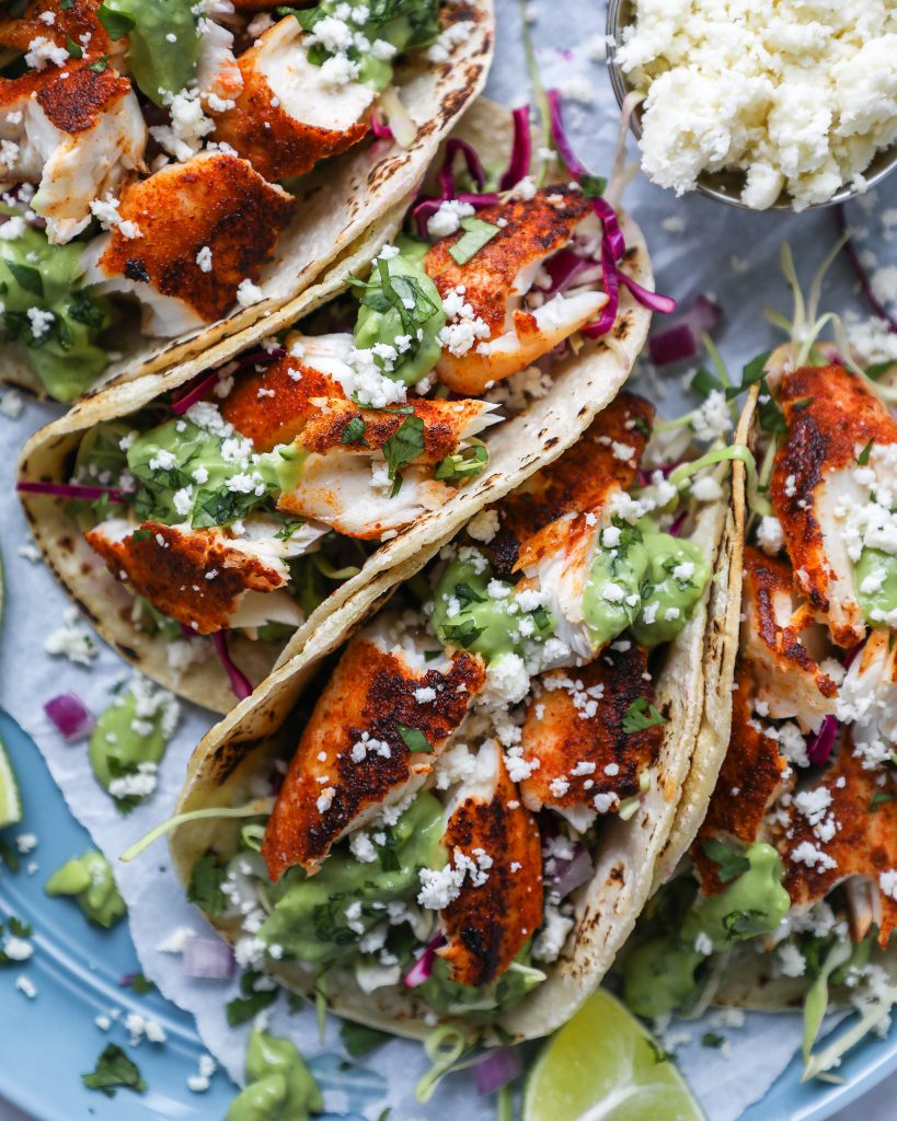 Chipotle rubbed tilapia, cilantro lime slaw and the best avocado sauce are all you need to make these tasty tacos!