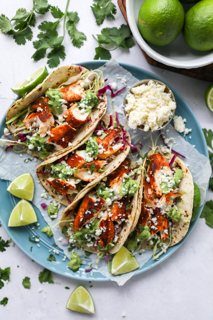 Upgrade your taco night with these simple fish tacos! They're spicy, creamy, tangy and full of Mexican spice!