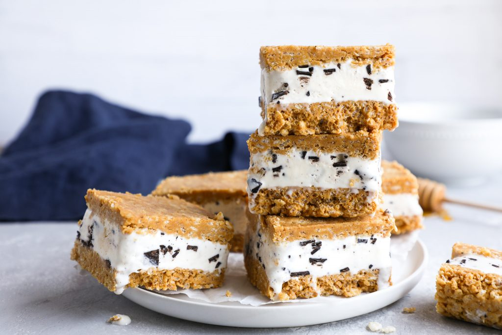 Ice cream sandwiches made with rice krispie treats sitting on a plate