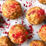 Peanut butter and jelly protein balls with crumbled freeze dried strawberries