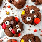 Chocolate peanut butter monster cookies that are gluten free, made with simple ingredients and taste absolutely amazing! They full of chocolate, peanut butter, m&m's and candy eyes.