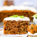 Easy moist zucchini cake made with warm spices and topped with a healthier cream cheese frosting. Plus it's dairy free, refined sugar free and oil free too!