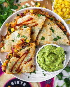 Easy barbecue chicken quesadillas made with shredded chicken, corn onion, cheese and cilantro all stuffed into an almond flour tortilla. It's a great option for an easy weeknight meal!