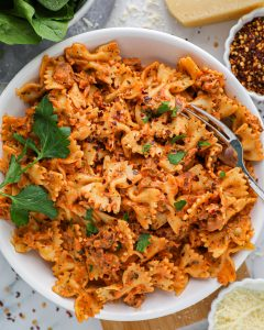 An easy bow tie pasta recipe that's made with a creamy and spicy vodka sauce. It's perfect for a healthy weeknight meal!