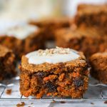 Easy, one bowl carrot cake blondies that are just as healthy as they are delicious! They're topped with a lightened up cream cheese frosting that is just perfect for springtime!