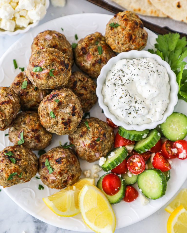 Easy Greek turkey meatballs that are made with simple ingredients and served with your favorite tzatziki sauce! They're great for an appetizer or even as a main meal!