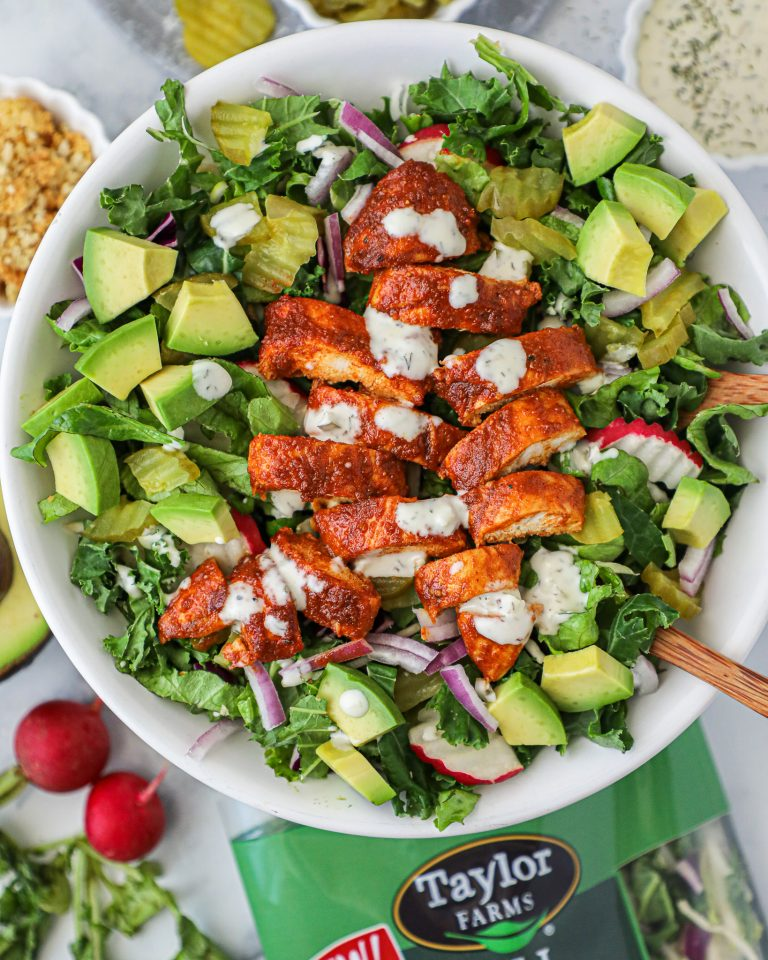 Healthier nashville hot chicken that's baked instead of fried and topped over a fresh greens and dill pickle salad!