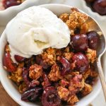 You just can't beat this easy summertime dessert! It's made with fresh cherries, a sweet cinnamon crunch topping and is topped with creamy vanilla ice cream!