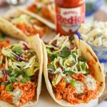 Easy, healthy and delicious! These baked buffalo chicken tacos have just the right amount of heat and are perfect for taco night!