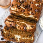 Cream cheese swirled chocolate chip zucchini bread is the perfect baking recipe to make this fall! It's easy, delicious and made with simple ingredients!