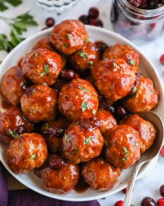 Healthier cranberry bbq turkey meatballs that are baked to perfection and tossed in a simple 2 ingredient sauce! They're the perfect appetizer for the holidays!