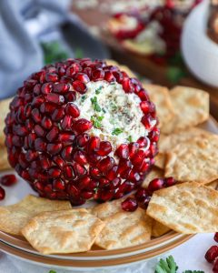 Only 6 ingredients make up this healthier cheese ball! It's made with cream cheese, white cheddar cheese, pecans, green onion, salt and pomegranate arils!