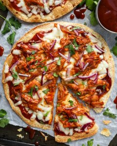 BBq sauce, shredded chicken, red onion, mozzarella, cilantro and flour tortillas are all you need to make these delicious pizzas! They're ready in minutes and are so easy too!